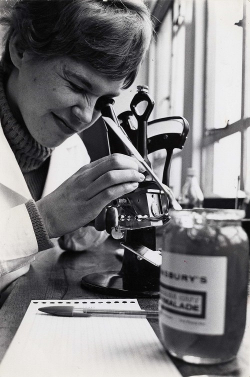 SA/BL/IMA/16/3 - Photograph of chemical laboratory assistant examining Sainsbury's Marmalade with refractometer