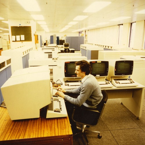 SA/BL/IMA/4/4 - Photograph of employee working on computer terminals in a computer room