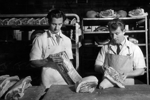 SA/BL/IMA/7/2 - Photograph of butchers examining meat in factory
