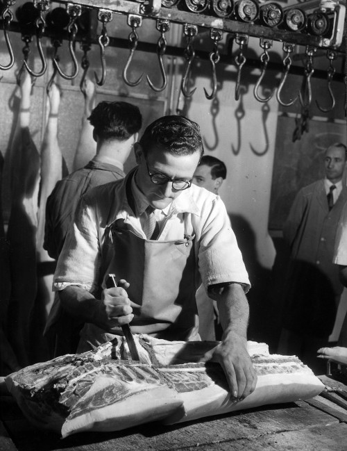 SA/BL/IMA/7/4 - Photograph of butcher cutting meat in factory