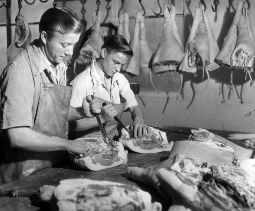 SA/BL/IMA/7/5 - Photograph of butchers cutting meat in factory