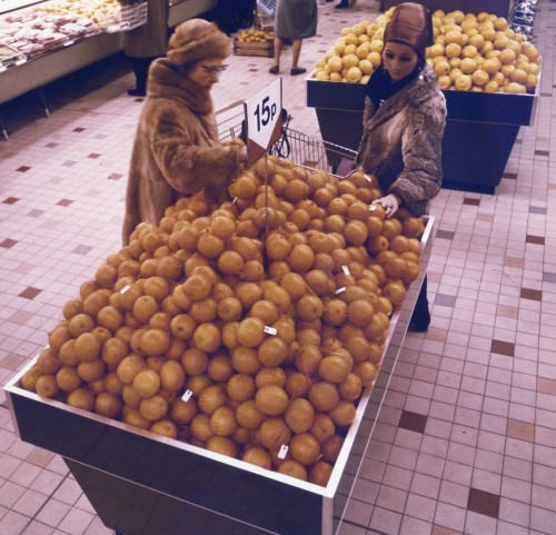 SA/BR/5/IMA/3/3 - Photograph of fruit display in a Sainsbury's supermarket with customers picking fruit, 1970s