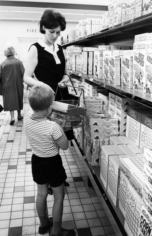 SA/BRA/5/11/3 - Photograph of mother and child selecting cereal from the cereal aisle in a Sainsbury's supermarket