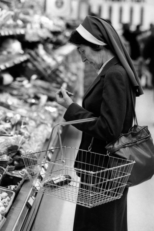 SA/BRA/5/11/6 - Photograph of nun with basket in supermarket