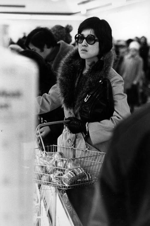 SA/BRA/5/11/7 - Photograph of stylish customer with basket in store