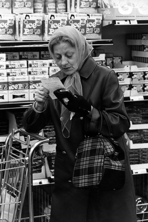 SA/BRA/5/11/9 - Photograph of customer examining shopping list next to ice pops display