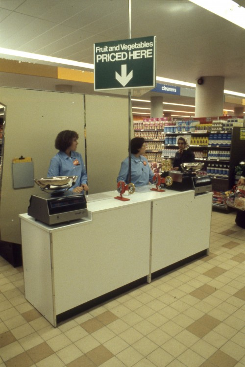 SA/BRA/7/A/11/3/7 - Photograph of fruit and vegetable pricing counter, opening day,  Park House, Park Street, Ashford store