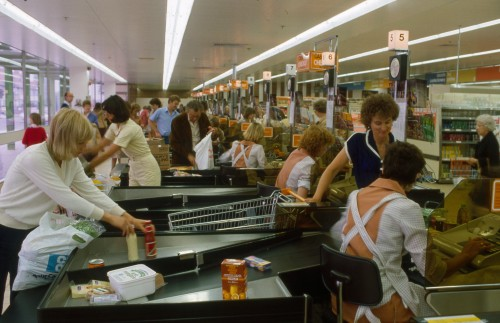 SA/BRA/7/B/19/97 - Image of staff and customers at the checkout area at Woodchurch Road, Birkenhead branch