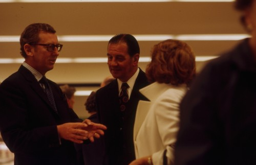 SA/BRA/7/C/4/2/104 - Image of Cambridge (44 Sidney Street) opening day: J.D. Sainsbury (with unidentified man) talking to customer
