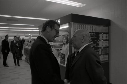 SA/BRA/7/C/4/2/27 - Image of Cambridge (44 Sidney Street) opening day: J.D. Sainsbury greeting a woman and man