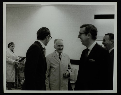 SA/BRA/7/C/4/2/84 - Image of Cambridge (44 Sidney Street) opening day: Simon Sainsbury, Mr Lovegrove, and J.D. Sainsbury