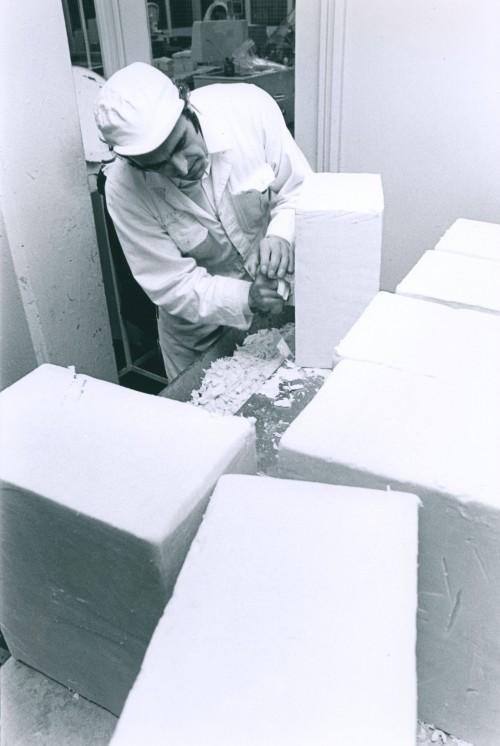 SA/DEP/2/4/3/38 - Photograph of man scraping cheese at Basingstoke Depot, March 1975