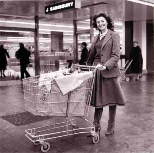 SA/PKC/PAC/6/5/2/1 - Photograph of (model customer) with trolley bag, 1983