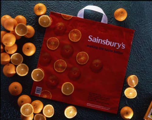 "SA/PKC/PAC/6/5/2/2 - Promotional photograph of ""Making Life Taste Better"" orange bag for life with sliced oranges"