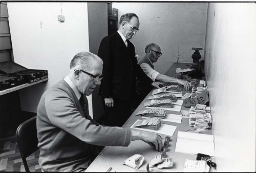SA/REG/OFF/4/1/7 - Photograph of Norwich House, Streatham offices - men counting money