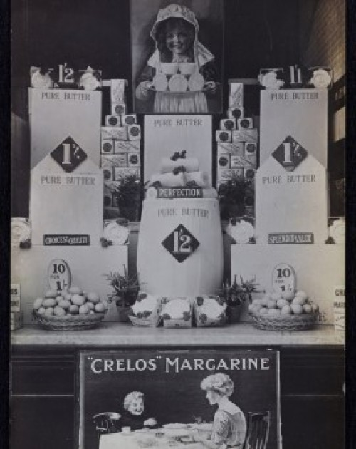 Image of Crelos Margarine, Pure Butter, tea and eggs window display