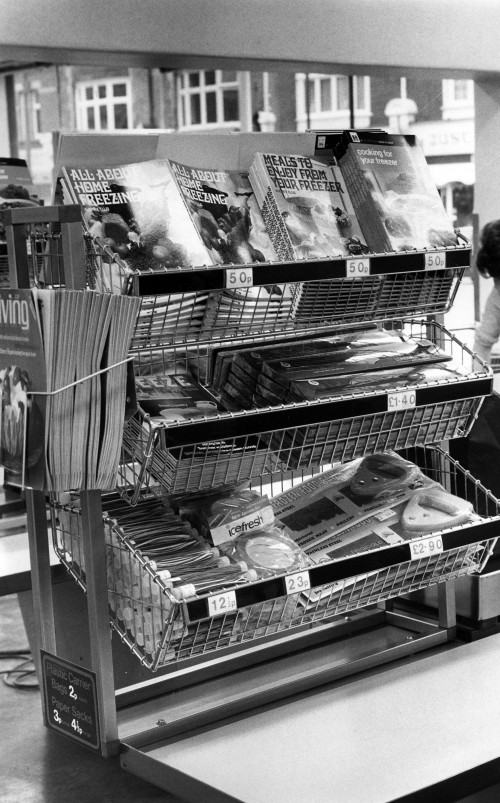 SA/SUB/FRE/6/13 - Photograph of publications and freezer accessories display at checkout in a Freezer Centre, 1970s