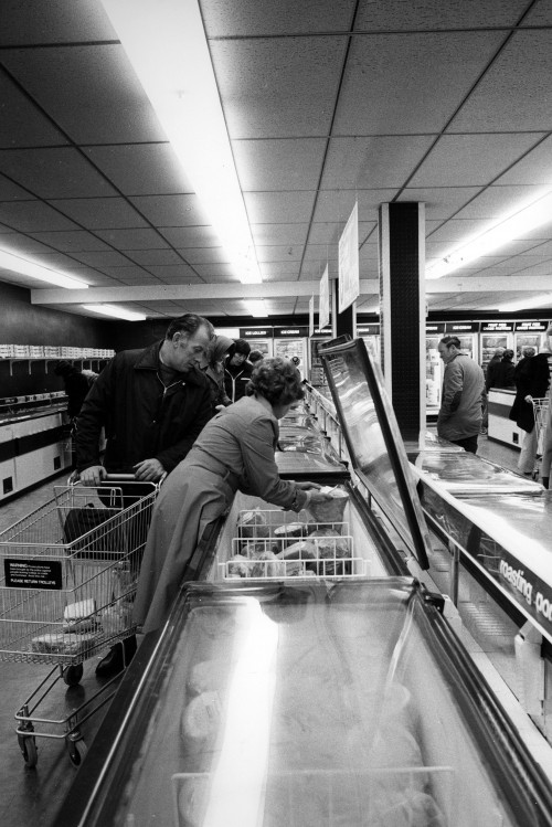 SA/SUB/FRE/6/8 - Photograph of Hornchurch Freezer Centre: customers picking items from freezer on opening day, 1978