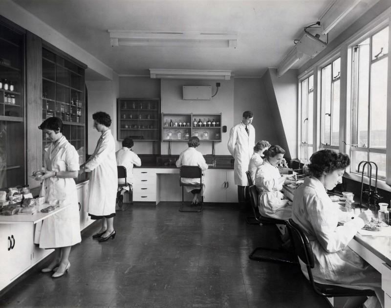 SA/BL/IMA/16/1 - Photograph of technicians at work in laboratory, 14th March 1957