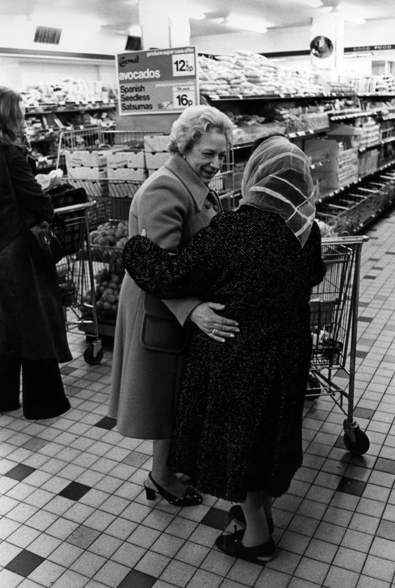 SA/BRA/5/11/4 - Photograph of two friends meeting inside a Sainsbury's supermarket