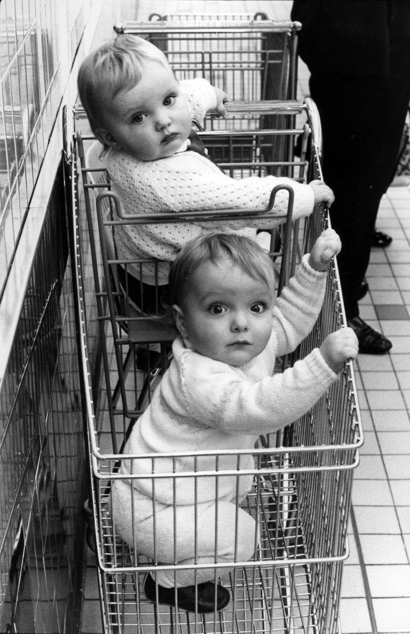 SA/BRA/5/11/5 - Photograph of two small children inside a trolley