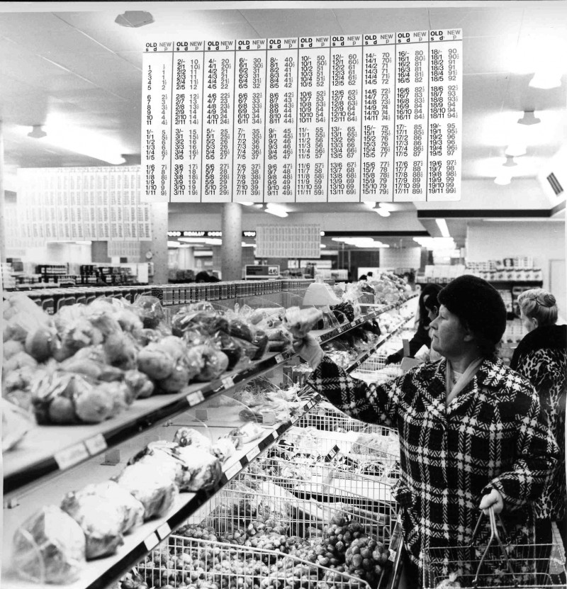 SA/BRA/5/9/8/1/1 - Photograph of store interior with decimalisation conversion table