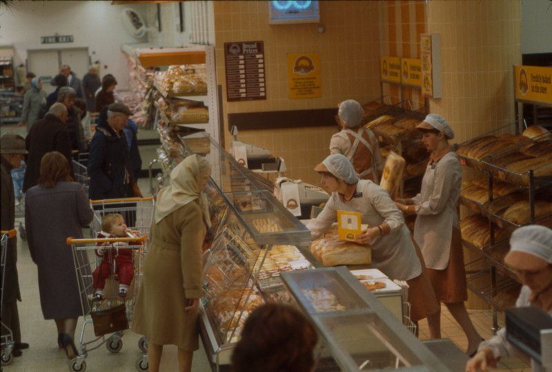 SA/BRA/7/B/25/20 - Image of staff serving customers at the bakery department at Red Bank Road, Blackpool branch