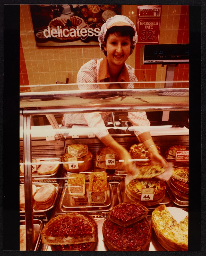 SA/BRA/7/B/25/8 - Image of an employee at the delicatessen department at Red Bank Road, Blackpool branch