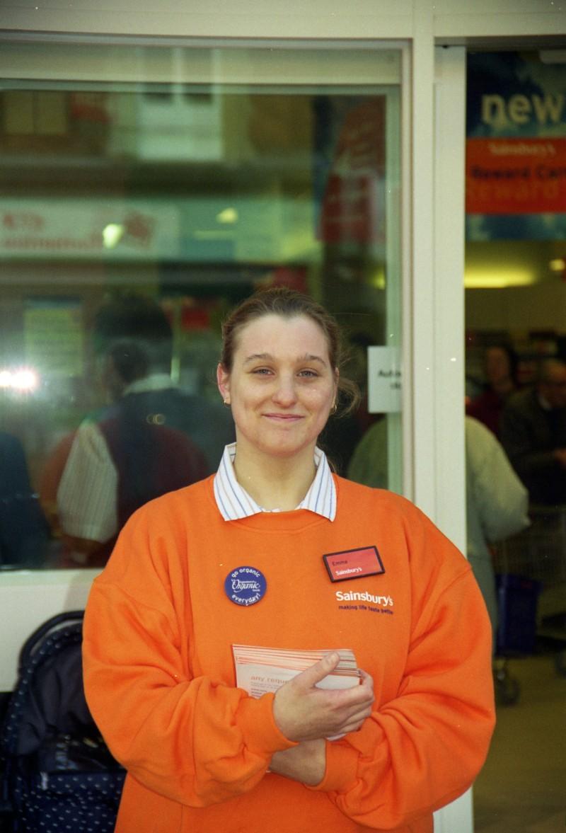 SA/BRA/7/B/31/3/64 - Image of a staff member outside 637/641 Christchurch Road, Boscombe branch