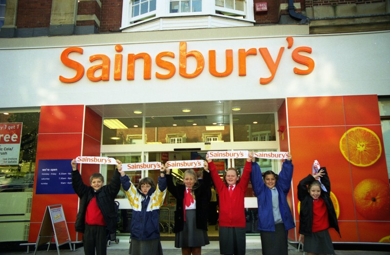 SA/BRA/7/B/31/3/67 - Image of children holding Sainsbury's banners outside 637/641 Christchurch Road, Boscombe branch