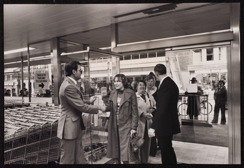 SA/BRA/7/B/31/6/1/3 - Image of Winton (447/457 Wimborne Road) branch on opening day: first customer greeted by the manager Tony Lovegrove