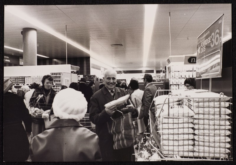 SA/BRA/7/B/31/6/1/4 - Image of Winton (447/457 Wimborne Road) branch on opening day: customers shopping
