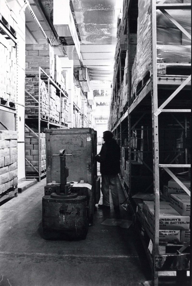 SA/DEP/4/6/17 - Photograph of fork lift truck and member of staff in Charlton Depot warehouse
