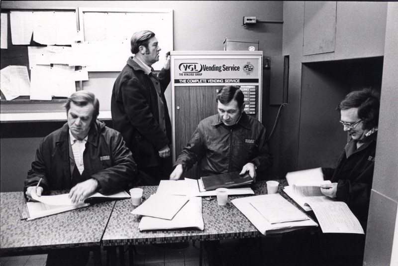 SA/DEP/4/6/20 - Photograph of Charlton Depot - staff members in office - drivers checking in