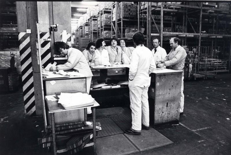 SA/DEP/4/6/39 - Photograph of group of employees in warehouse at Charlton depot, 1977