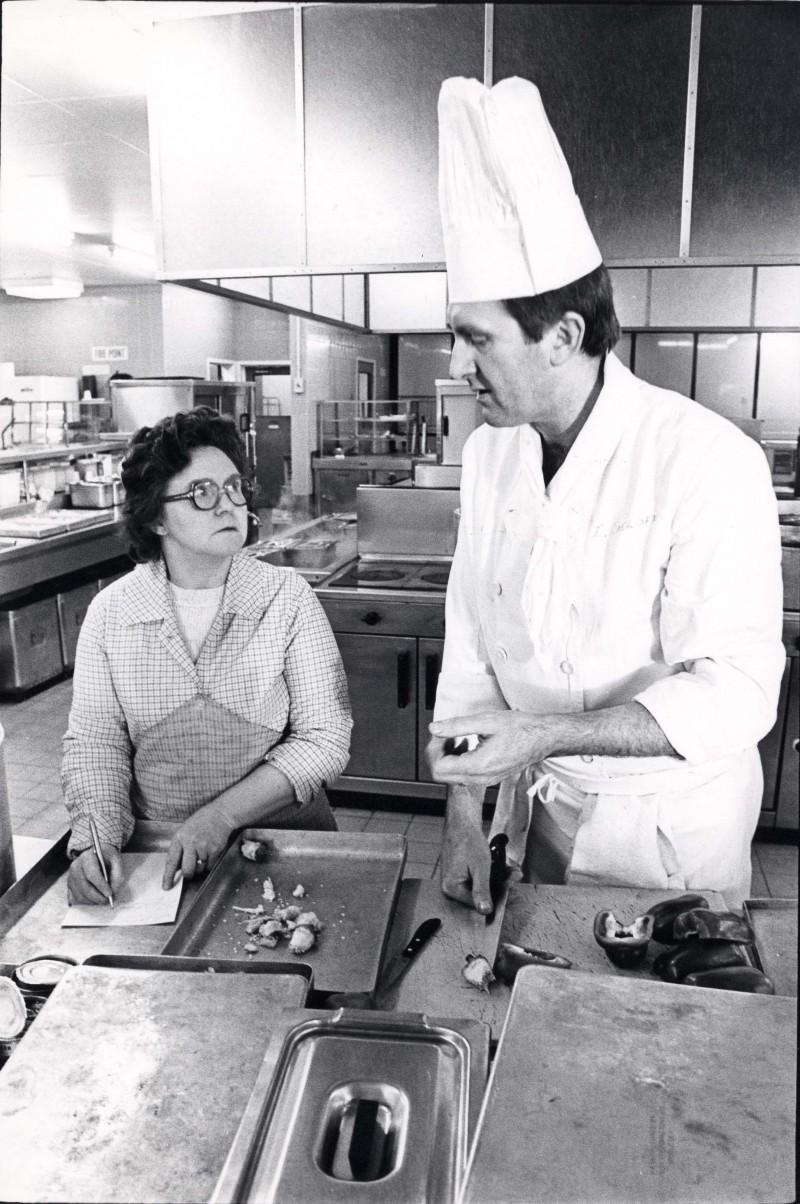 SA/DEP/4/6/50 - Photograph of Charlton Depot, 1977 - chef Eric Sidoff, Midge Cohen in kitchen