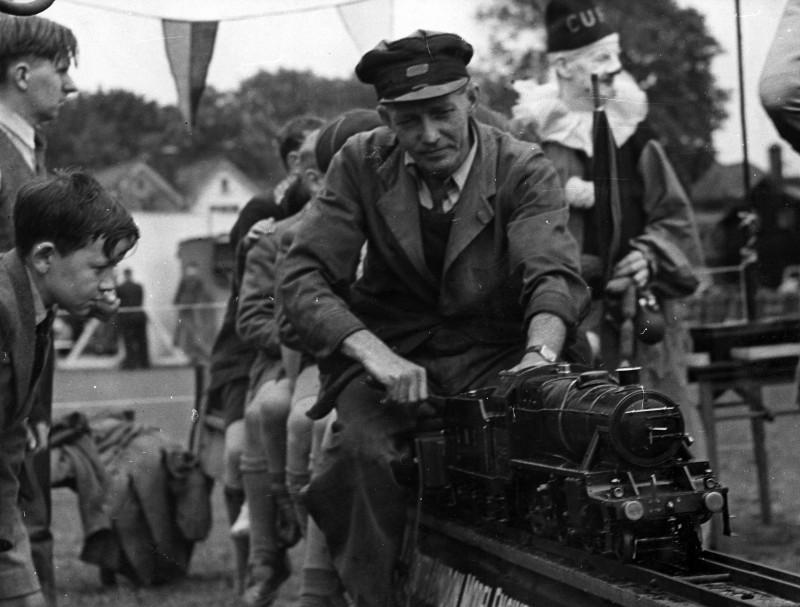 SA/EMP/SOC/3/IMA/4/2 - Photograph of model train ride at staff summer fete, c.1940