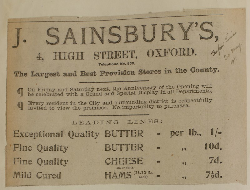 SA/MARK/ADV/1/1/1/1/1/6/1/95 - Newspaper advert for anniversary of opening of Oxford store offering 'leading lines in Butter, Cheese and Ham', 1911